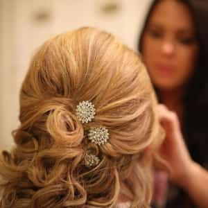 Bridal hair styling for wedding and makeup blonde